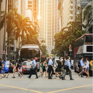 Image of people at a busy road crossing