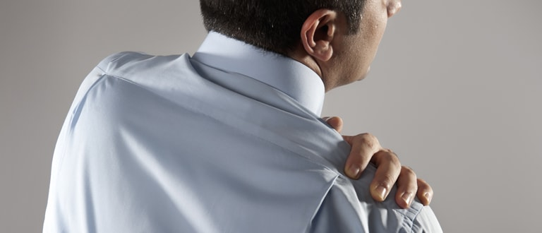 Image of man in pain holding his shoulder